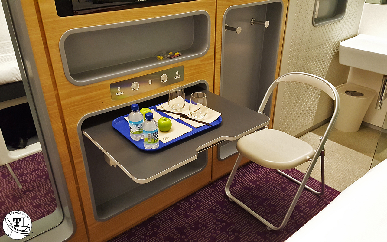 Space saving design includes a pop-up table and fold-up chair.